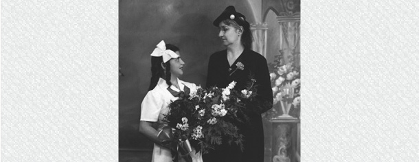 Mrs. Dermousis, Green language tutor, names Mother of the Year, receives bouquet on Mother's Day, 1940-1949