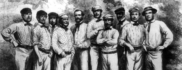 10 players, cricketeers, in various hats, bow ties