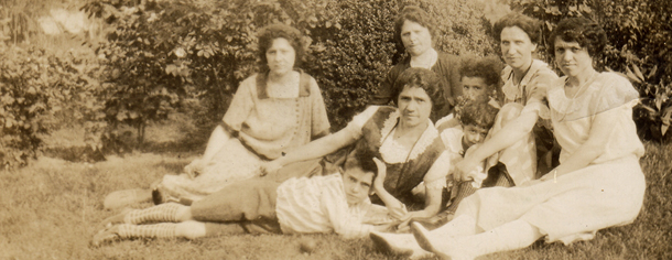 8 women posing on the lawn